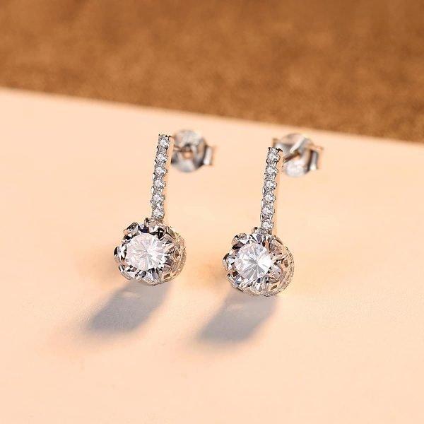 сребърни дроп обеци с малки камъчета и масивен кръгъл циркон