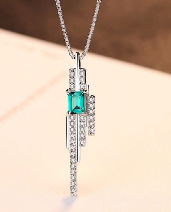 detailed frontal shot of silver necklace of Venetian braid with rectangular green topaz
