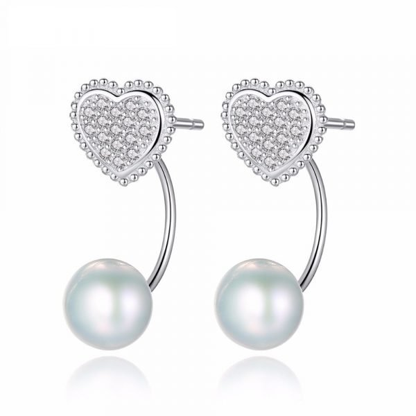 detailed shot on white background of heart-shaped silver earrings with cubic zirconia and pearl