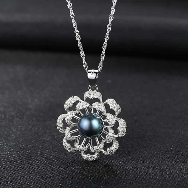 silver necklace with floral motif and dark blue Tahitian pearl