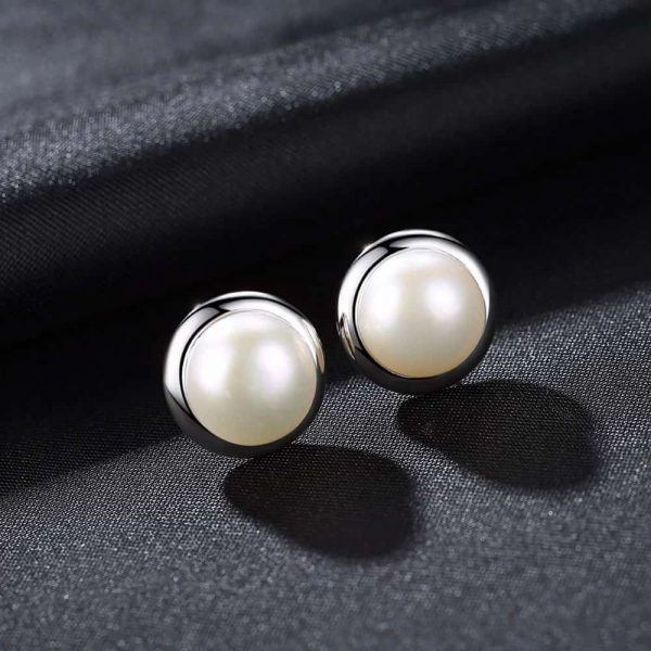 oval pearl earrings with silver screw circle