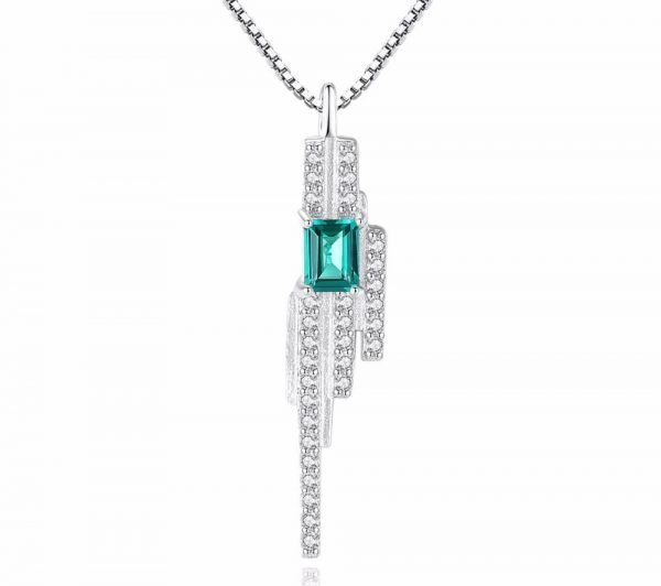 frontal shot with white background of silver necklace of Venetian braid with rectangular green topaz