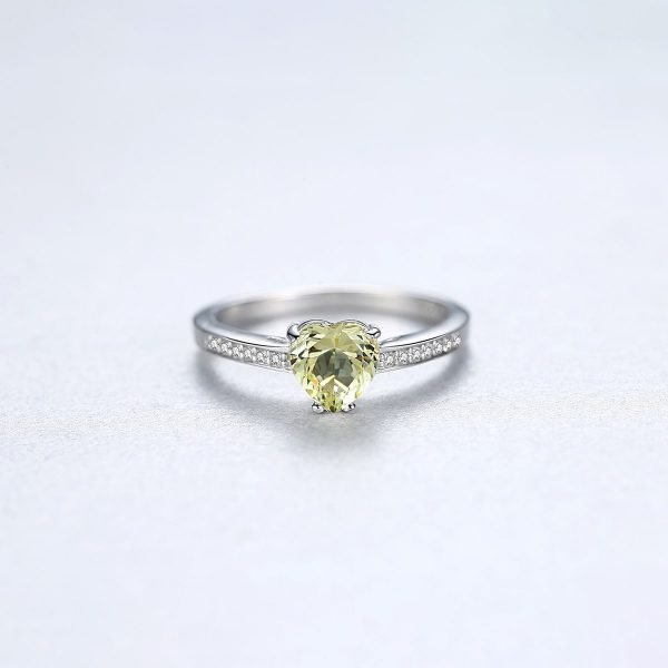 frontal shot of heart-shaped silver ring with greenish crystal