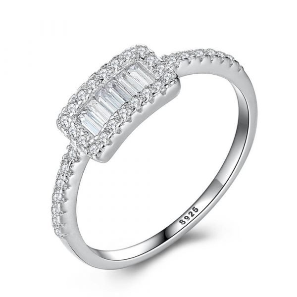 detailed photo of a clear silver ring with a rectangular shape and multiple cubic zircons on a white background