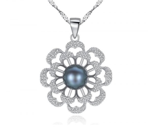 front detail shot of the back of a silver necklace with a floral motif and a dark blue Tahitian pearl