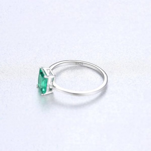 silver ring with rectangular green crystal