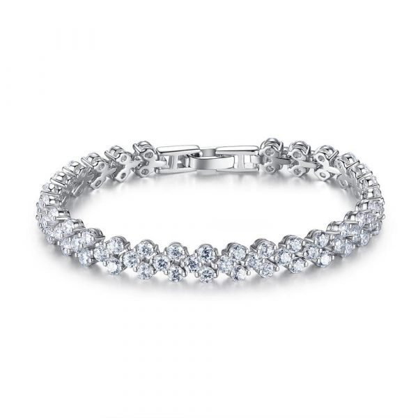 detailed shot of a solid silver bracelet with a large number of cubic zirconia and an elegant setting on a white background