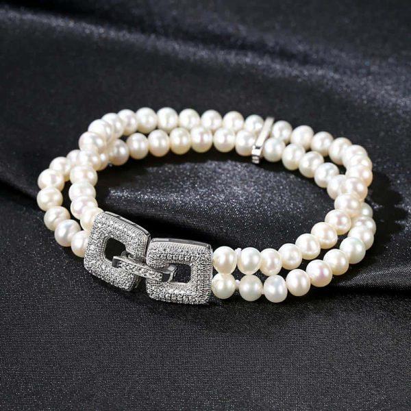 двуредова перлена гривна гривна с красива детайлна закопчалка покрита с циркони