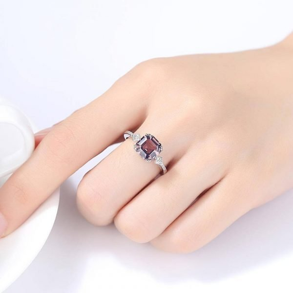 ladies hand with silver ring with massive pink-brown morganite
