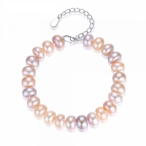 exquisite pearl bracelet with a pinkish tint of pearls photographed from above on a white background