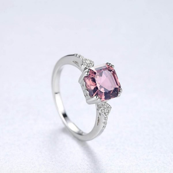 product photography of silver ring with massive pink-brown morganite