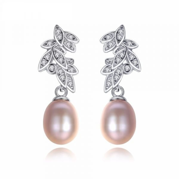dangling pearl earrings with floral motif and cubic zirconia photographed frontally on white background