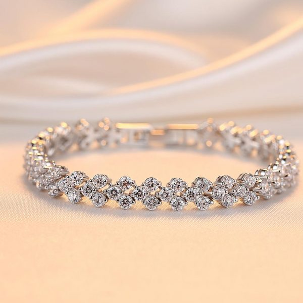 solid silver bracelet with a large number of cubic zirconia and elegant clasp photographed frontally on a bright surface