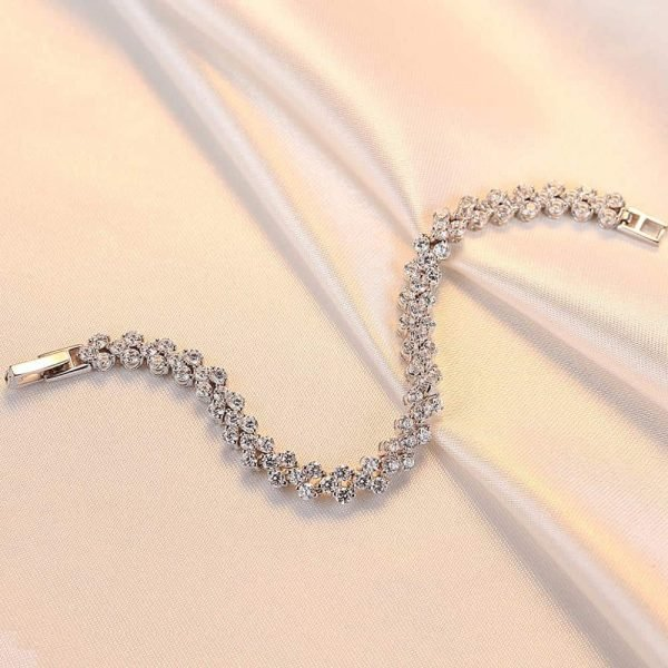 massive silver bracelet with a large number of cubic zircons - photographed unfastened from above