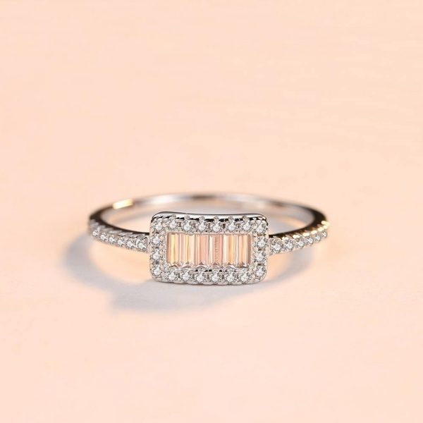 frontal shot of a clear silver ring with a rectangular shape and multiple cubic zircons placed lying down
