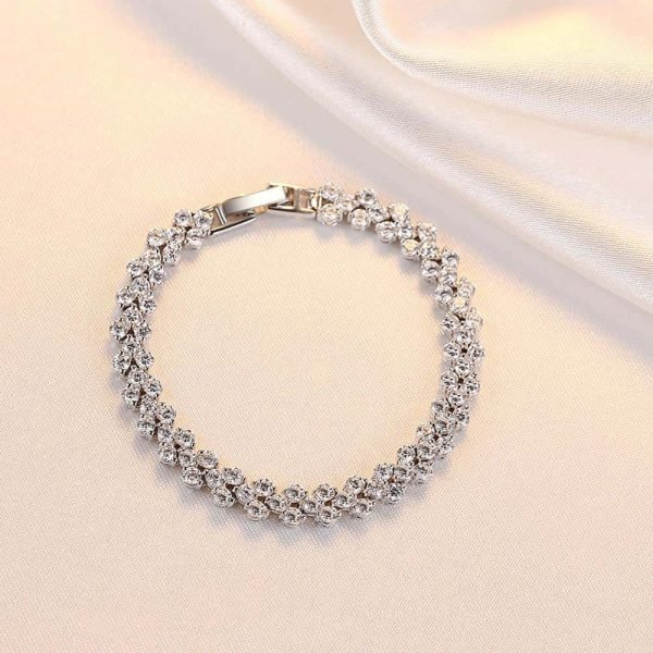 solid silver bracelet with a large number of cubic zirconia and elegant clasp photographed from above