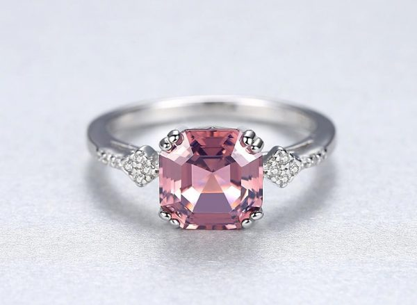 detailed frontal shot of silver ring with massive pink-brown morganite