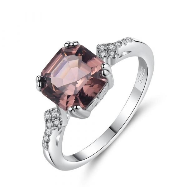 silver ring with massive pink-brown morganite photographed at a slight angle on a white background