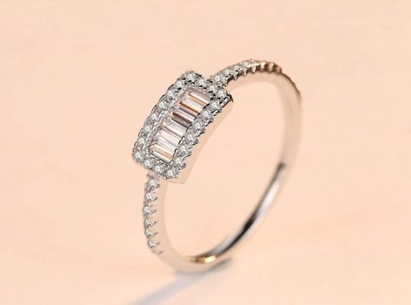 clean silver ring with rectangular shape and multiple cubic zirconia