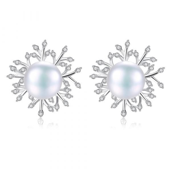 silver pearl earrings with branches studded with cubic zircons on white background