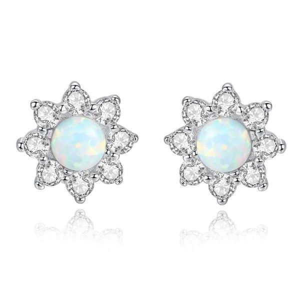 front shot of silver earrings with floral motif and light opal in the center