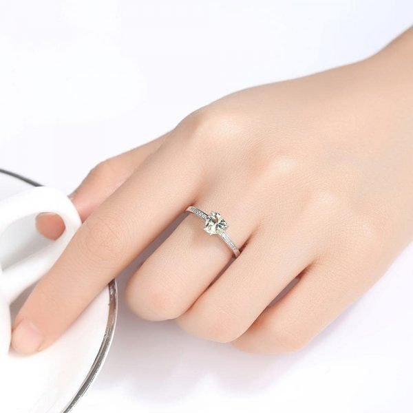 ladies model with heart silver ring with greenish crystal