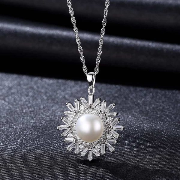 silver necklace with a massive pearl surrounded by numerous cubic zircons