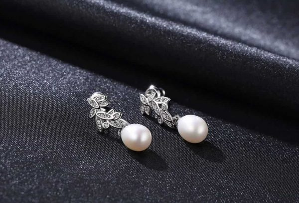 dangling pearl earrings with floral motif and cubic zirconia