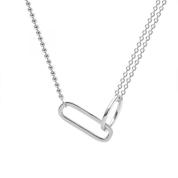 photo with white background of a silver necklace with two types of braids and two elements connecting them together