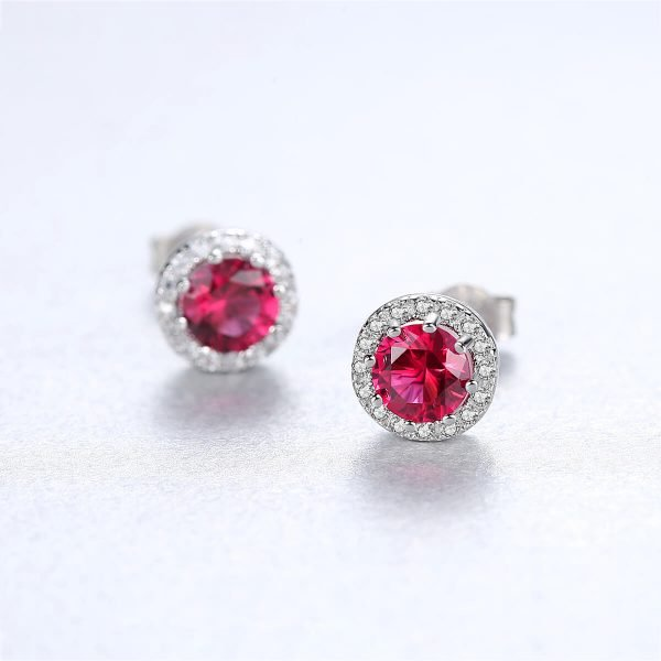 round silver earrings with massive ruby - photo with focus on one earring