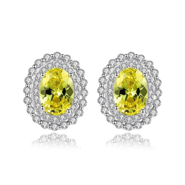 elliptical silver earrings with yellow synthetic topaz photographed on white background
