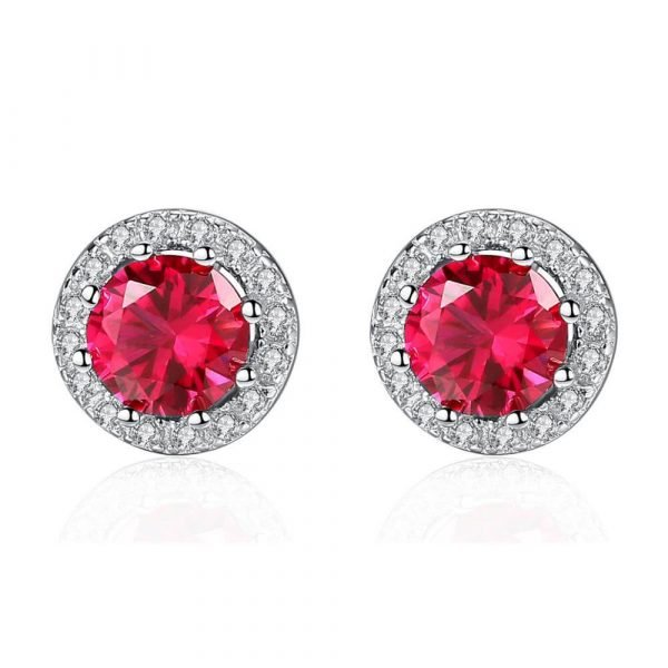 round silver earrings with massive ruby photographed on white background
