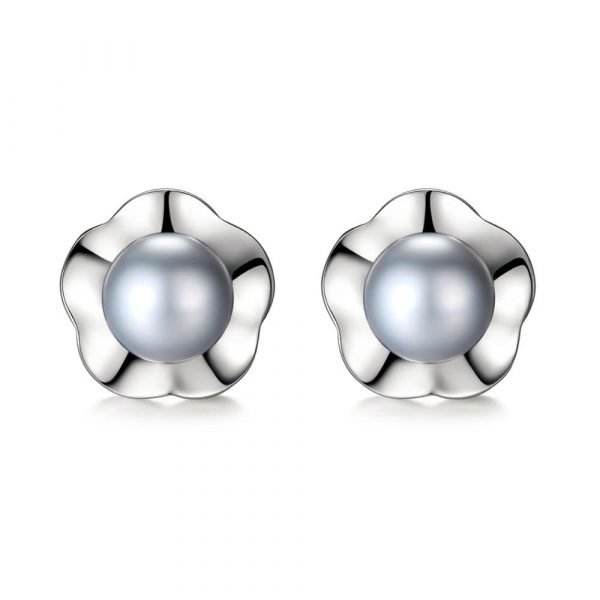 frontal shot with white background of silver earrings with light grey pearls and floral element behind them