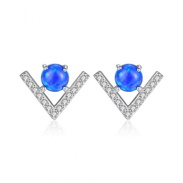silver earrings in the shape of the letter V and a round blue opal in the center photographed on a white background