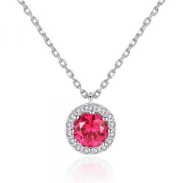 detailed photo of a silver necklace with a round pendant and a red ruby in the center on a white background
