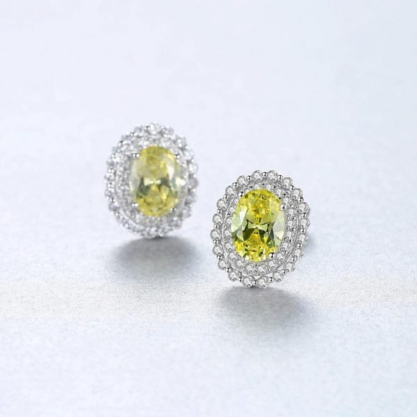 elliptical silver earrings with yellow synthetic topaz - focus on one earring