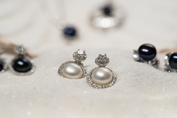 silver earrings with small cubic zircons and massive pearls in close-up