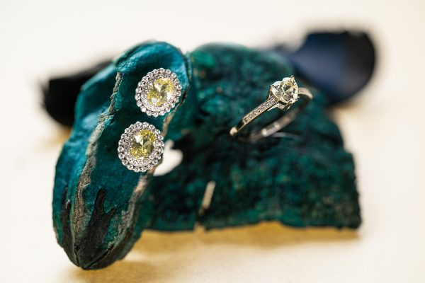 silver earrings and ring with cubic zirconia and massive yellow stone