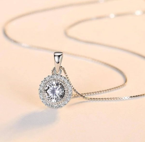 silver necklace with Venetian braid and oval pendant with massive cubic zirconia - photographed with focus on the pendant