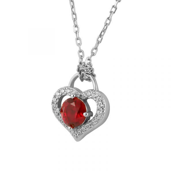silver necklace with classic braiding - focus on the heart-shaped element with red crystal
