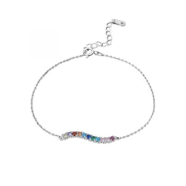 delicate silver bracelet with multicolored cubic zircons photographed on white background