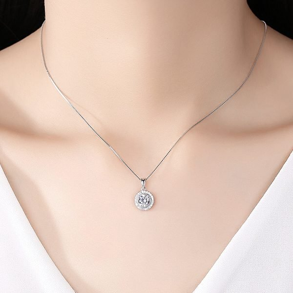 model with white blouse and silver necklace with Venetian braid and oval pendant with massive cubic zirconia