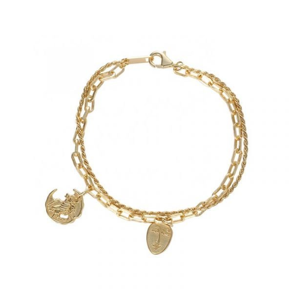 massive double silver bracelet with 18-carat gold plating photographed on white background