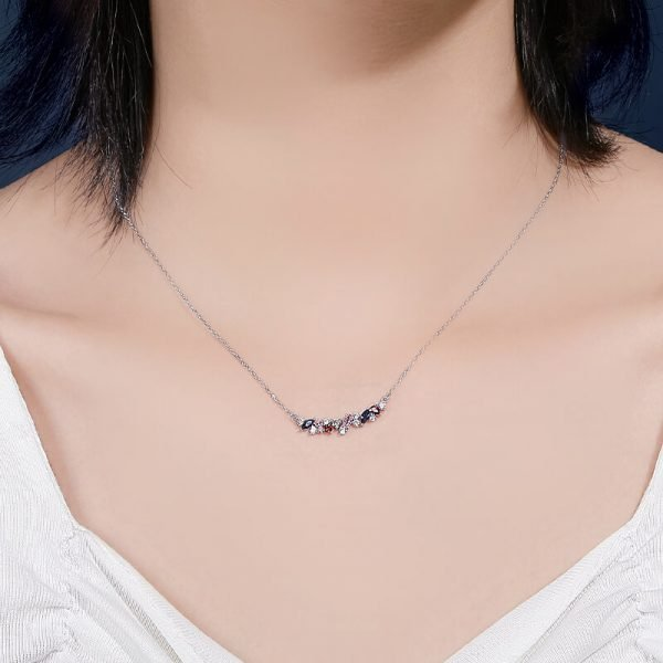 ladies model with delicate silver necklace with multicolored cubic zirconia