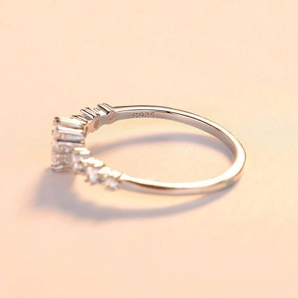 silver ring with a massive cubic zirconia and three smaller stones on each side - photo with focus 925 seal