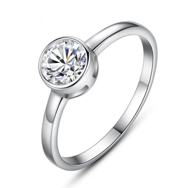 clear silver ring with round cubic zirconia photographed at an angle on a pure white background