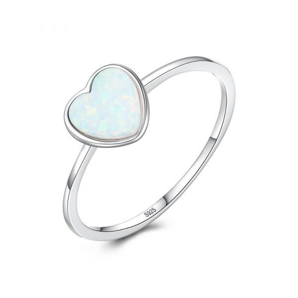 delicate silver ring with light blue synthetic opal in the shape of a heart