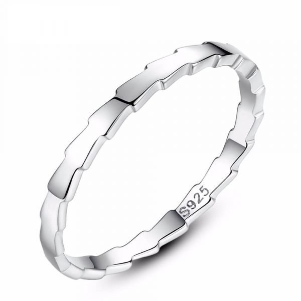product photography with white background on a clean silver ring with a jagged shape