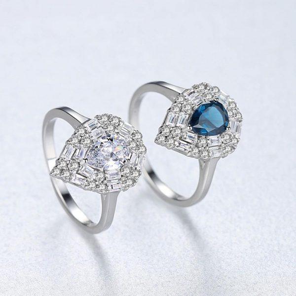 красив сребърен пръстен с масивен кубичен цирконий с капковидна форма в два цвята