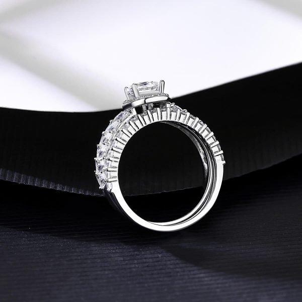 двоен сребърен пръстен с множество малки циркони и един по-масивен камък сниман отстрани